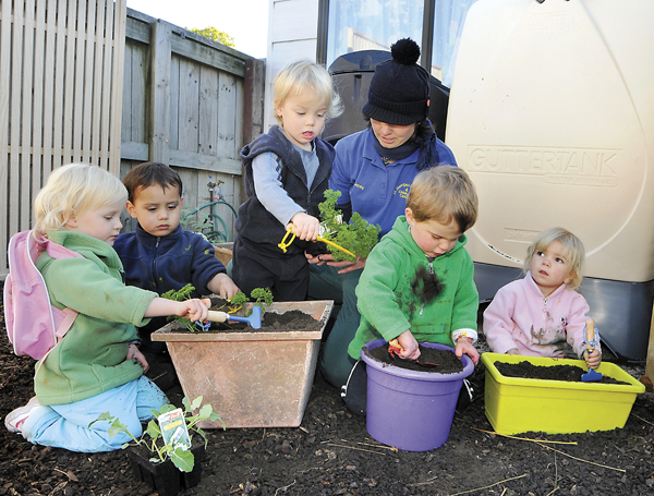 Children planting seeds